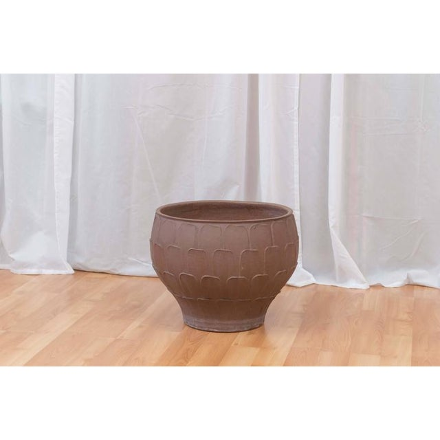 A Classic California Modern planter, circa 1960s by David Cressey for Architectural Pottery. This design is known by...