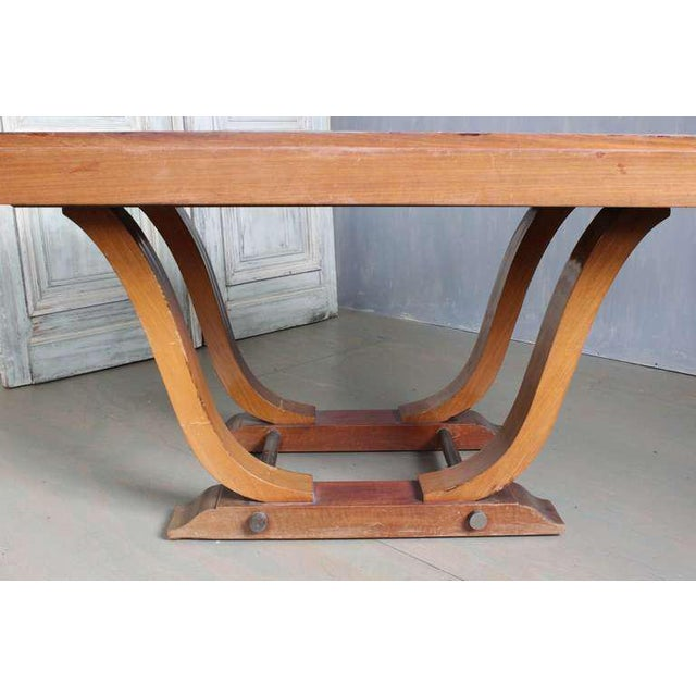French 1940s Art Deco style rosewood dining table with extensions on the end for leaves. The table is rosewood veneered...