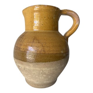 Late 19th Century French Earthenware Pitcher With Yellow Glaze For Sale