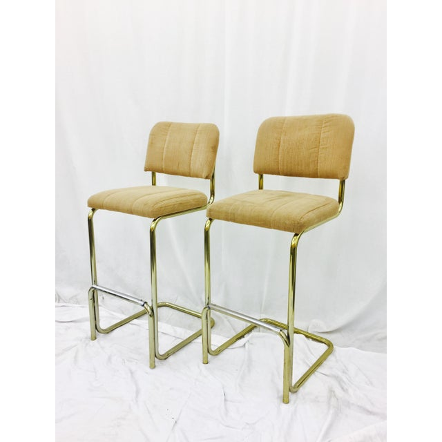 This set of 2 ( pair ) Lacquered Brass Cantilever Bar Stools are a must have for a design lover! The construction and...