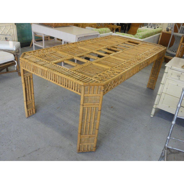 intricate natural bamboo dining table with an inset glass top.