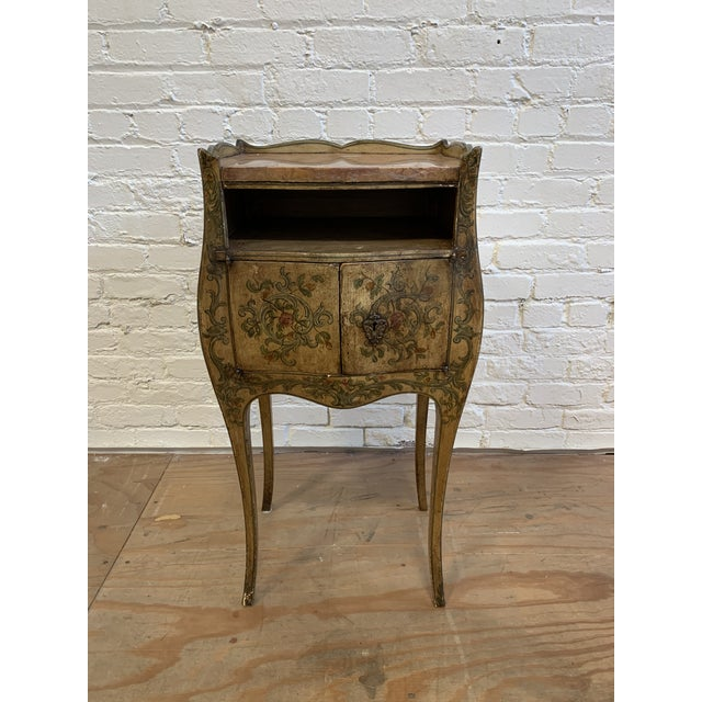 Design Plus Gallery presents a French inspired Hand Painted Side Cabinet + Marble Top. Floral and vine motifs surround the...
