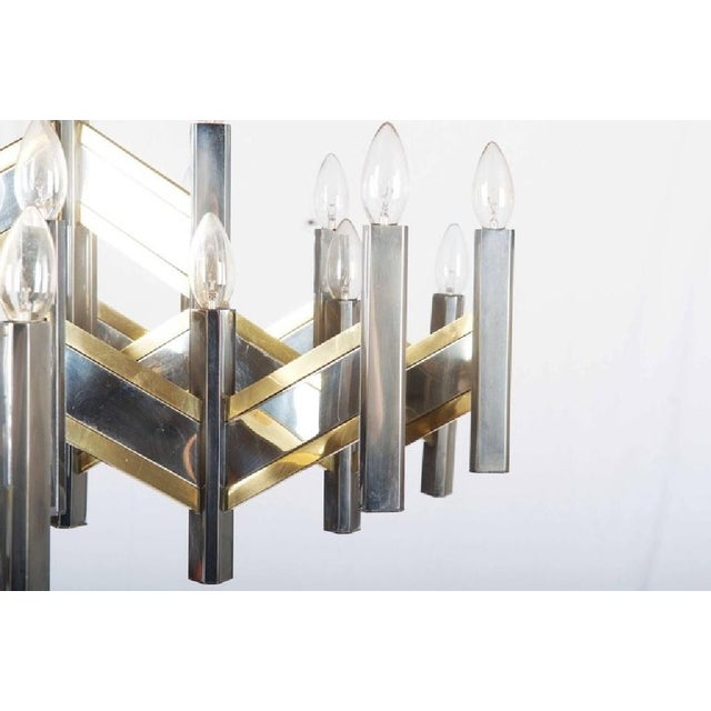 This is a chevron zig zag body shape chandelier, fitted with 21 E14 lights up to 60 watts, and designed by Gaetano...