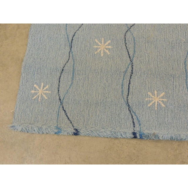 Edward Fields Rug in Shades of Blue Weaved in 2001 with a snowflakes pattern. 100% Virgin wool depicting the infinite star...