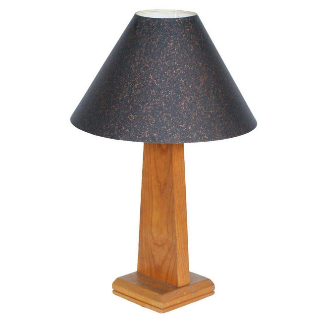 Mid-Century table lamp with hand-carved African figural accents, circa 1950.