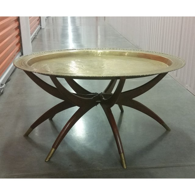 This authentic Mid Century Modern oval brass top coffee table in a Moroccan Style is a Must Have for any MCM décor! The...