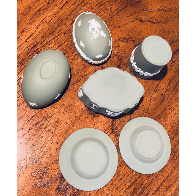 Beautiful matte bisque finish on a set of 5 pieces of vintage sage green Wedgwood Jasperware. Includes: cup, scalloped...