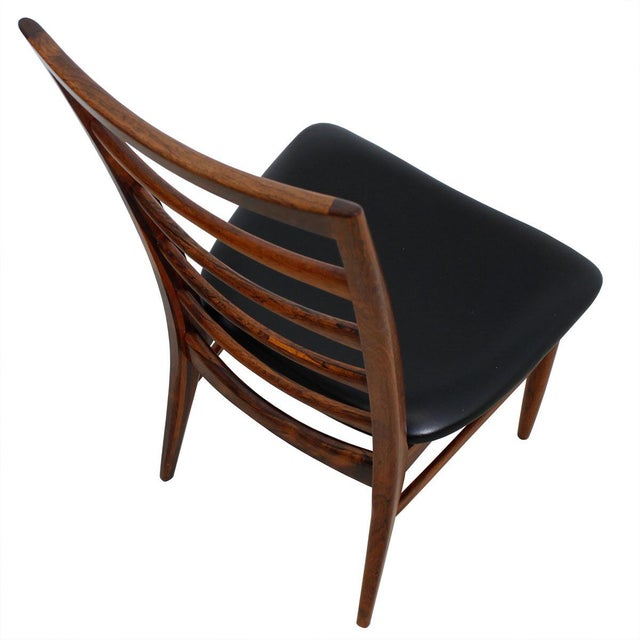 Beautifully proportioned and refined set of rosewood ladder back chairs from Koefoeds Hornslet. Two arm chairs and four...
