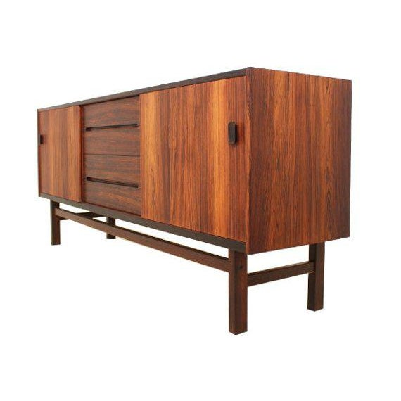 Mid Century Modern Rosewood sideboard designed by Nils Jonsson for Troeds. Two sliding doors with a flank of 4 drawers in...