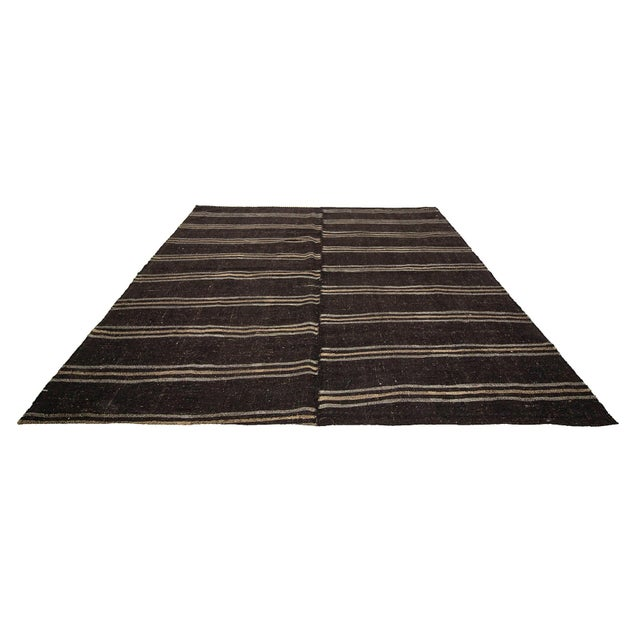 Handwoven striped vintage goat hair kilim rug from Afyon region of Turkey. Approximately 50-60 years old. In very good...