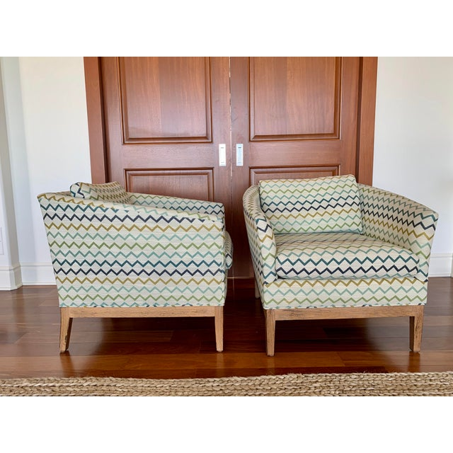 Pair of club chairs in chevron pattern with blue and green hues. Deep, plush seating. Walnut wood base/legs. Lee Industries.