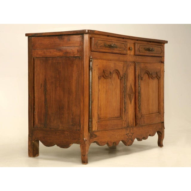 Circa 1780-1800 Country French Louis XV style, two drawers, over two door buffet. Our Old Plank workshop spent over a...
