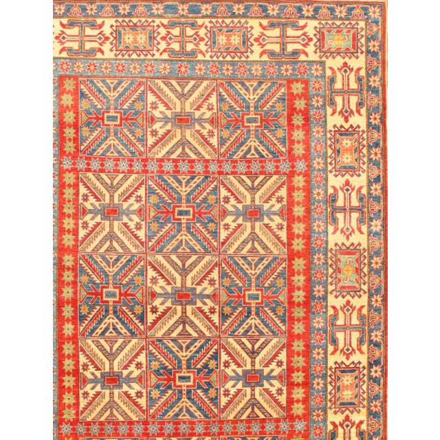 This is a hand-knotted KAZAK rug by Pasargad N Y. Hand-Spun Wool Rug All natural Dyed This rug is handmade from...