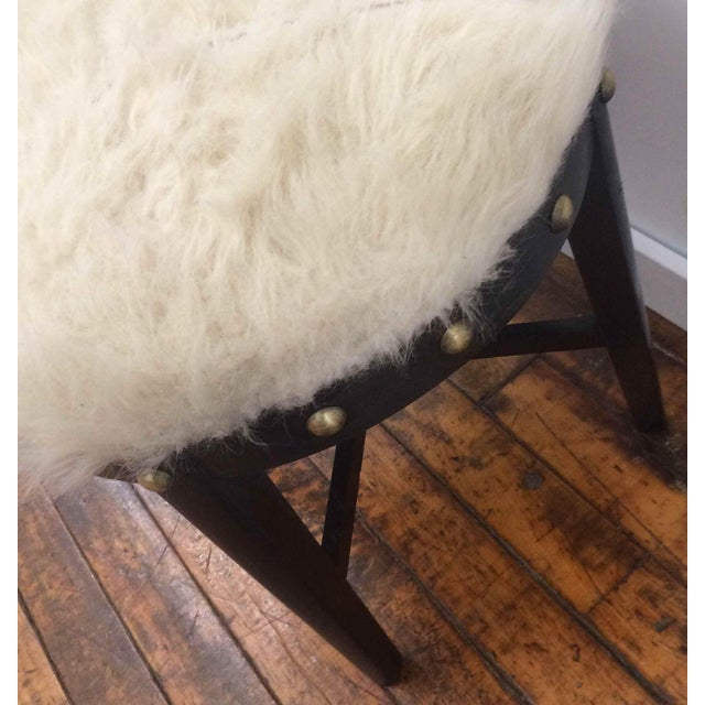 Wonderful one of a kind stool, with a repurposed Mid-Century frame. Faux fur, no animal products. Black finish on wood....