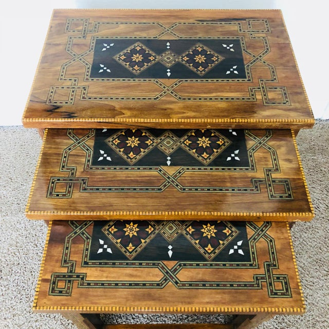 Amazing one of a kind set of nesting tables. The tables inlaid with natural wood like olive wood, rose wood, lemon wood...