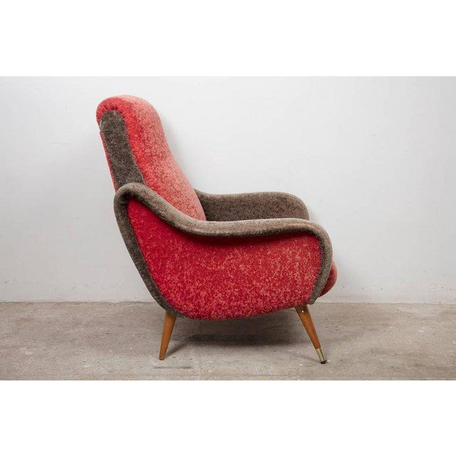 These armchairs organic and sculptural designed are iconic examples of Italian design from the 1950s, upholstered in the...