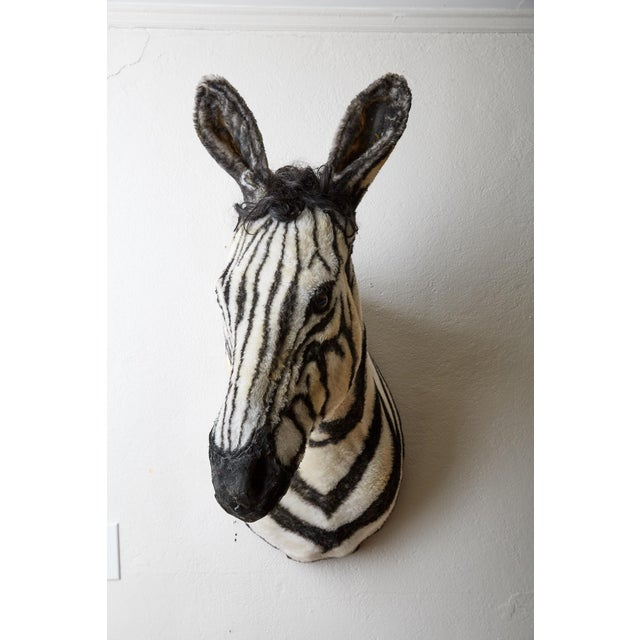 This unique sculpture is artfully crafted from wood, faux black and white zebra print fabric, and synthetic hair. It was...