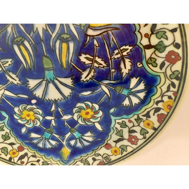 Polychrome hand painted and handcrafted ceramic wall decorative plate with polychrome floral design. This is an...