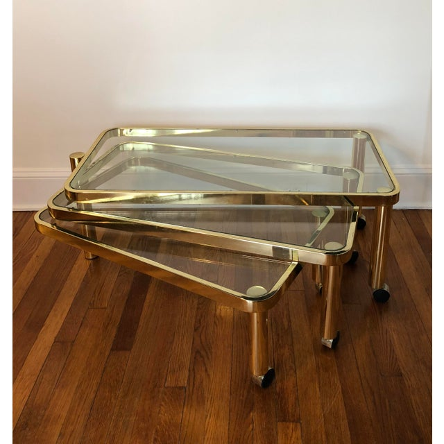 3e63f43e7e078 Awesome unique nesting polished brass nesting tables with pivoting gateleg.  A lot of surface table