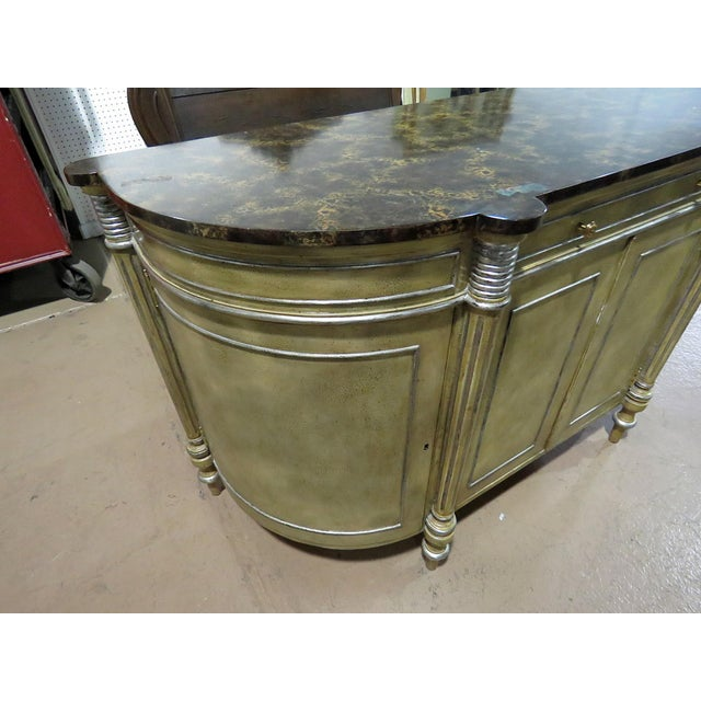 Maitland Smith faux marble top distressed painted commode with 1 drawer over 4 doors containing 3 shelves.