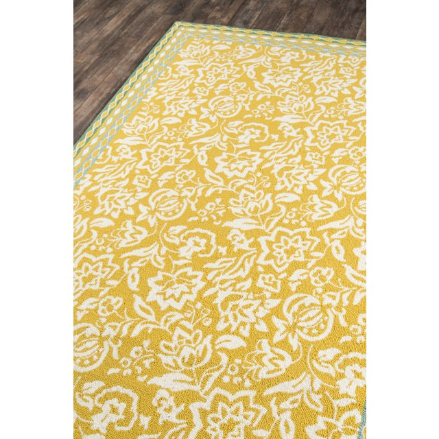 An ultra-colorful play on the traditional chintz pattern makes this indoor/outdoor area rug a must have for the modern...