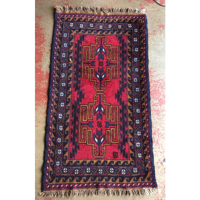 Stunning antique handmade wool tribal rug. Fabulous depth colors and composition. Entirely made by hand. Has fantastic age...