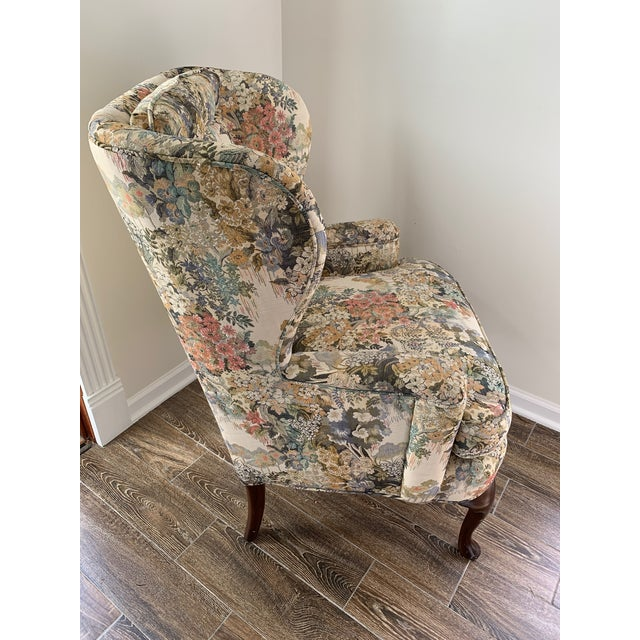 Beautiful custom upholstered wingback chair features a woven floral fabric of light blue, light pink and light green a...