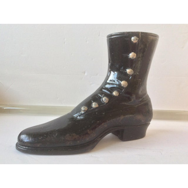 Charming antique cast iron boot with original paint and open bottom for mounts.