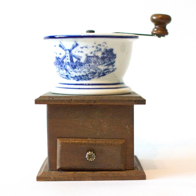 Antique coffee mill with wooden base and ceramic bowl with Dutch farmhouse scene. The mill grinds beautifully and is fully...