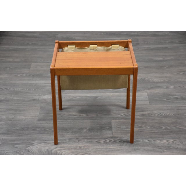 "A mid century modern teak and canvas magazine rack/end table by BRDR Furbo Spøttrup. Made in Denmark. 17.75"" wide. 17.5""..."