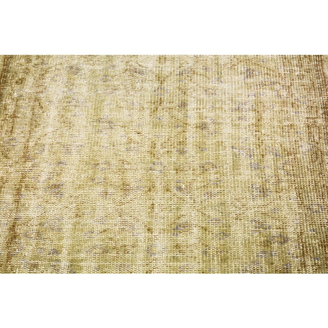 Vintage Turkish Oushak runner rug with natural colors and soft hand spun wool with allover pattern.