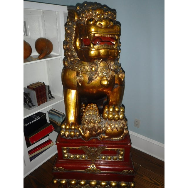 For sale are my hand carved wooden Foo Dogs they are 5 feet tall. I have owned them for 20 years. I bought them in an...