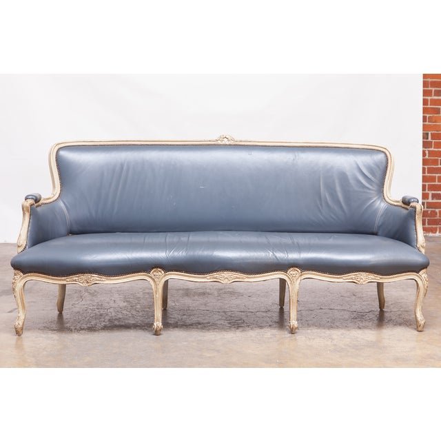 Stunning 1890s antique Louis XV style canapé sofa upholstered for William Gaylord in a French blue leather. Lovely painted...