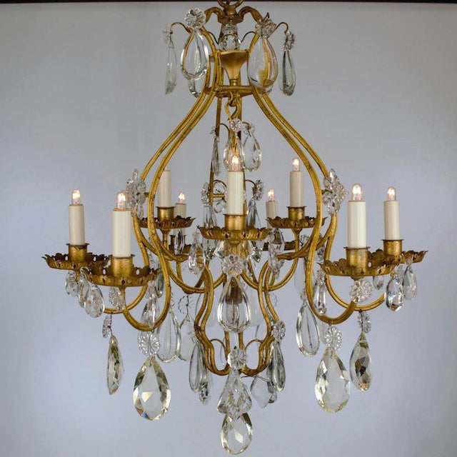 We present an elegant late 18th century Continental (French or Italian) iron chandelier featuring the highest quality of...