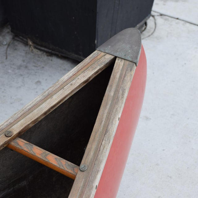 For your consideration a vintage Old Town Canoe in red color with wood and brass accents. Shows sings of vintage wear....
