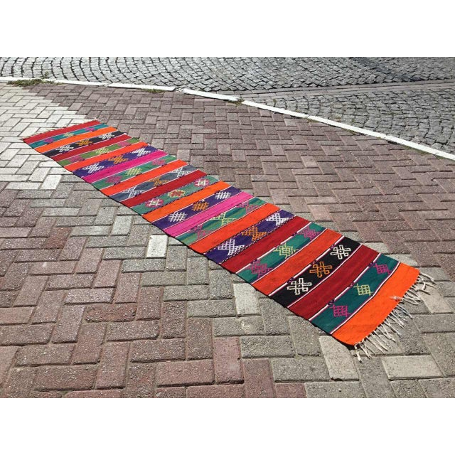 This beautiful, vintage, handwoven kilim rug is approximately 60 years old. It is handmade of hand spun wool in all...