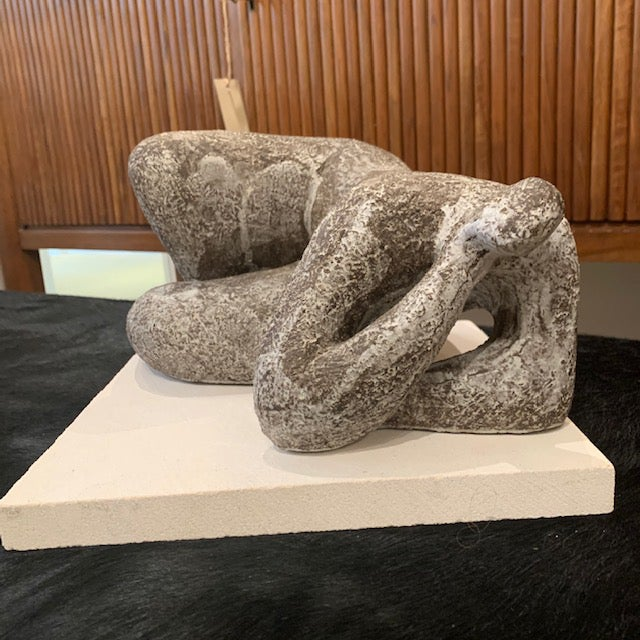 """Reclining sculpture in gres noir clay entitled """"Nuit Blanche"""" on stone base. By contemporary French artist Cristelle..."""