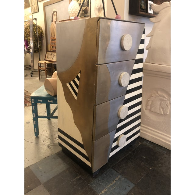 This is a fantastic Memphis style chest of drawers circa 1990 from a furniture store in Las Vegas.