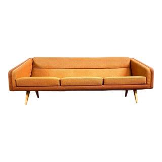 Mid Century Orange Sofa with Maple Legs For Sale