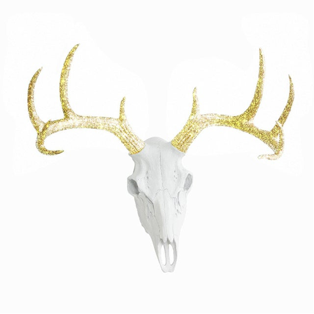 Make your walls charming with the Wall Charmers Deer Skull head faux taxidermy in white and gold glitter. This fake Deer...