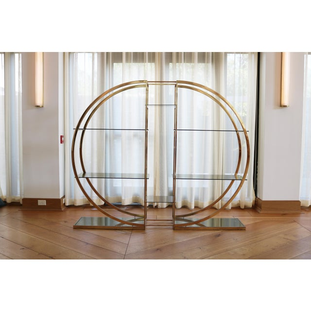 Circular brass Milo Baughman etagere pair or statement display shelves. Versatility to combine as one piece or separate...