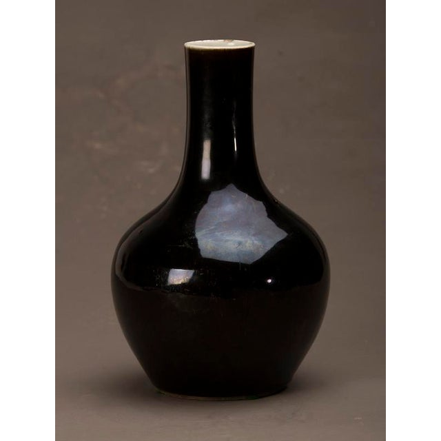 A very elegant black glazed porcelain vase from the Kuang Hsu period in China c. 1875.