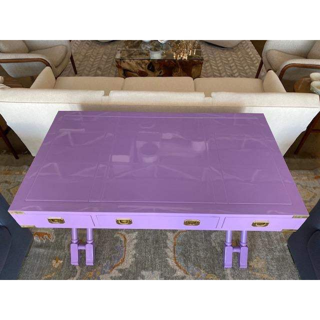 Fresh lavender lacquer campaign desk with brass accent and pulls. Made in the 1970s.