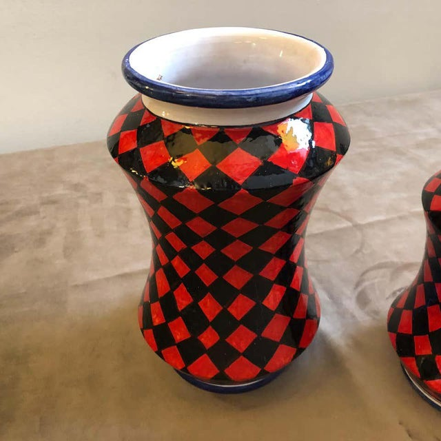 Three hand painted terracotta vases made in Sicily, they are unique pieces especially made for our shop and signed on the...