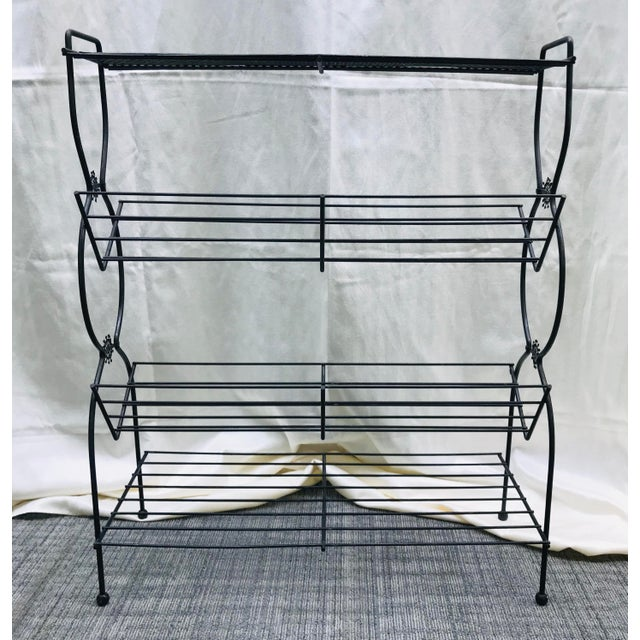 Fun retro MCM black wire plants stand - book shelf combo piece with atomic burst details on the side. Really a versatile...