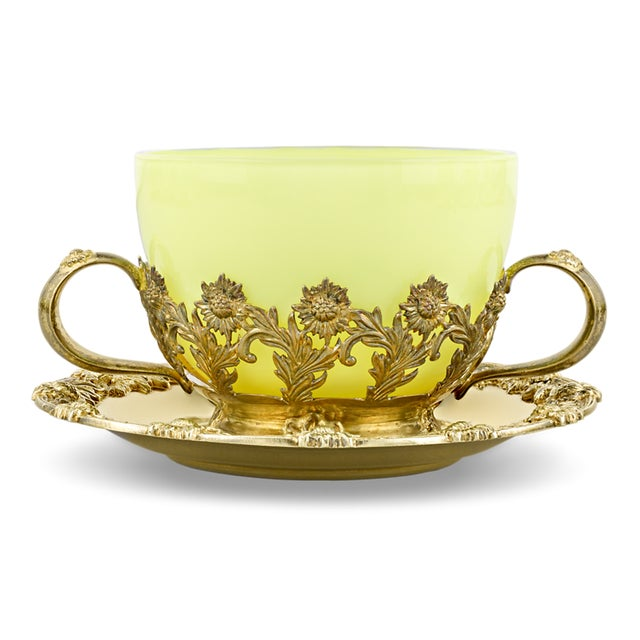 This resplendent service of 8 teacups was created by the famed Tiffany & Co. The rare and exquisite service blends the...
