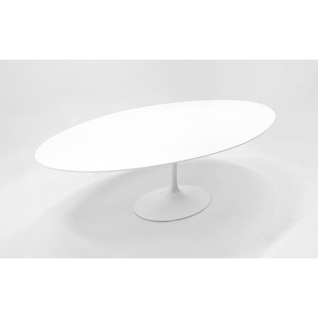 Eight foot Saarinen for Knoll oval dining / conference table. White laminate top and white tulip base. This is the largest...