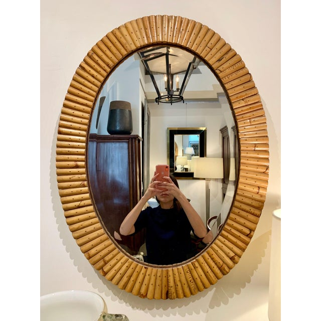 "Oval pieced bamboo wall mirror, the mirror with a beveled edge. France, circa 1960s. Size: 24"" W 32"" H"