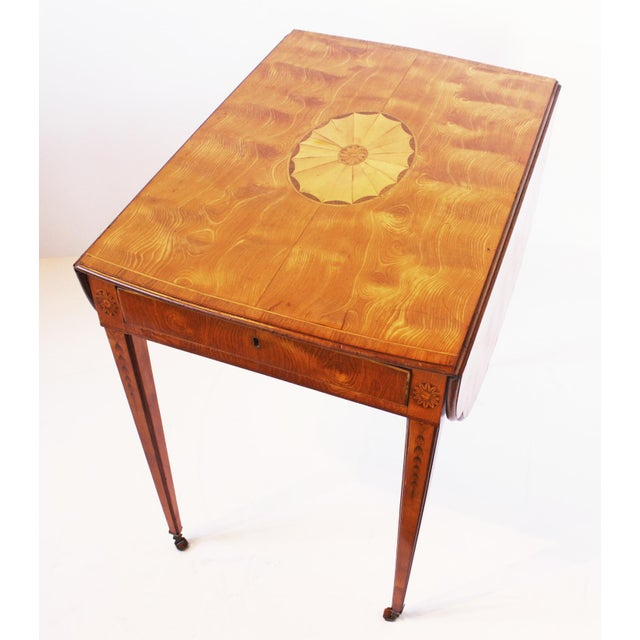 A spectacular George III Sheraton Period highly figured curly satinwood and crossbanded rosewood and marquetry Pembroke...