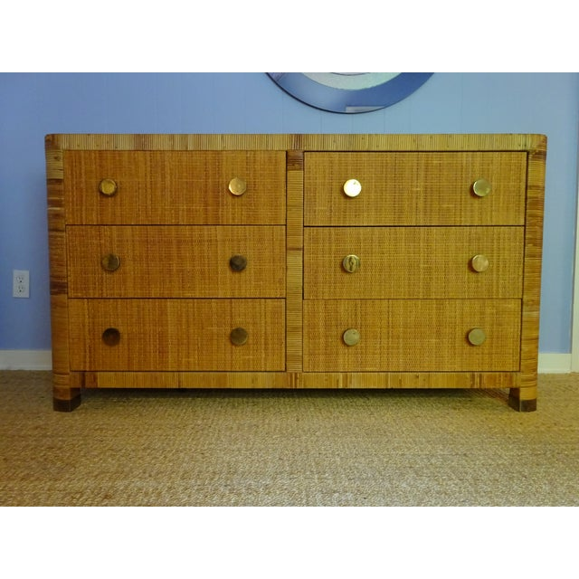 Crafted of cane, this Mid-Century Modern double chest or dresser was made by Bielecky Brothers. Bielecky Brother's are all...
